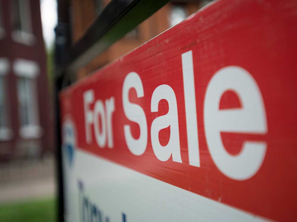 Canada's mortgage insurer tightens rules